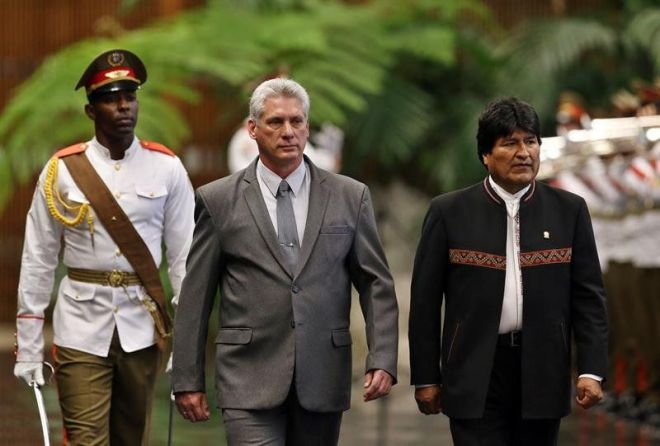 Miguel Diaz-Canal walks with Bolivia's Evo Morales.