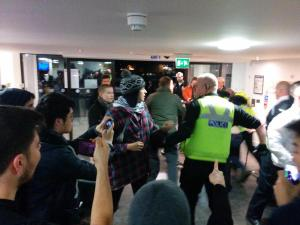 Police officer reaches for CS spray at Warwick