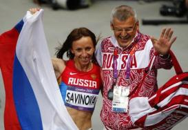 Russia's Mariya Savinova poses for photos with coach Vladimir Kazarin after she won the women's 800m final during the London 2012 Olympic Games at the Olympic Stadium August 11, 2012. REUTERS/David Gray
