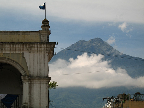 Guatemalan Flag and Agua Volcano