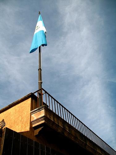 Guatemalan Flag at a Rooftop Pole