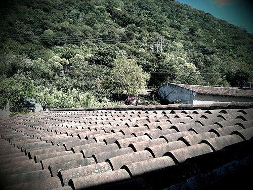 Spanish Tiles Roof Top by Rudy Girón