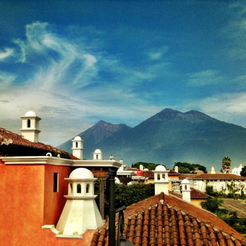 Cupolas and Volcanoes are the Typical Vistas from Antigua Guatemala by Rudy Girón