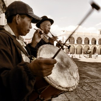 Drummer and Chirimilla Flute Player in Antigua Guatemala by Rudy Giron