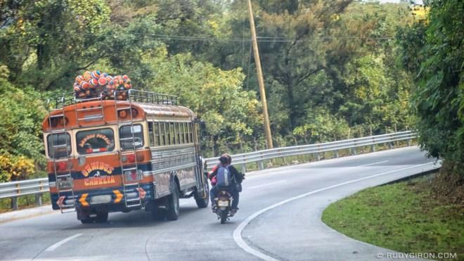 Rudy Giron: AntiguaDailyPhoto.com &emdash; Chicken Bus Climbing a Hill Very Fast
