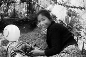 Rudy Giron: Antigua Guatemala &emdash; Smiling Maya Woman at the Park