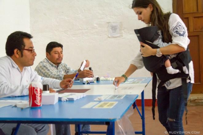 Rudy Giron: Antigua Guatemala &emdash; Mother with baby casting vote in Antigua Guatemala