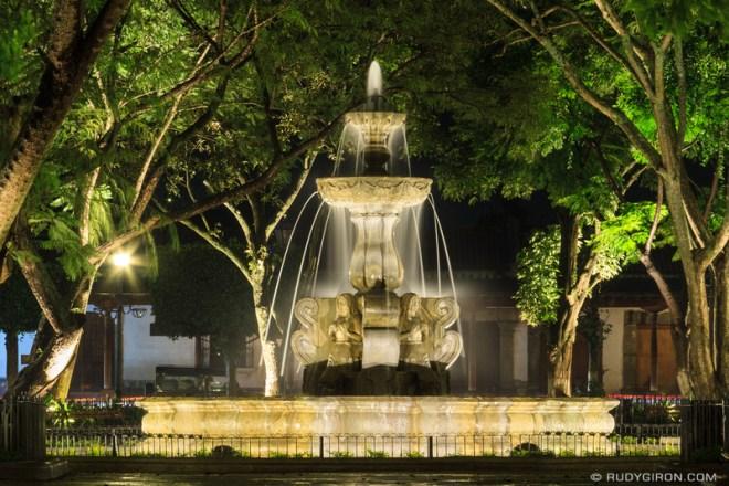 Rudy Giron: Antigua Guatemala &emdash; Fuente de las Sirenas At Parque Central During a Rainy Night