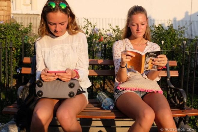Rudy Giron: Antigua Guatemala &emdash; Two women reading an ebook and book in Antigua Guatemala