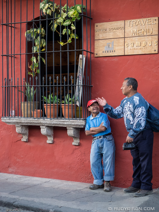 Rudy Giron: Antigua Guatemala &emdash; Two men talking on the streets of Antigua Guatemala