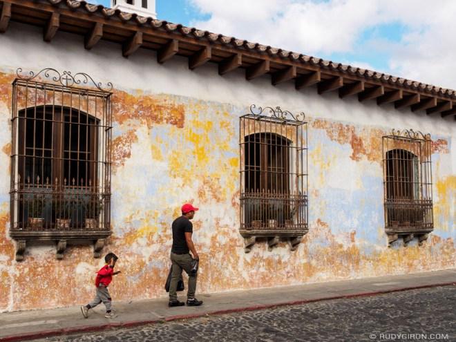 Rudy Giron: Antigua Guatemala &emdash; Guatemalan father and son walking in front of texture wall