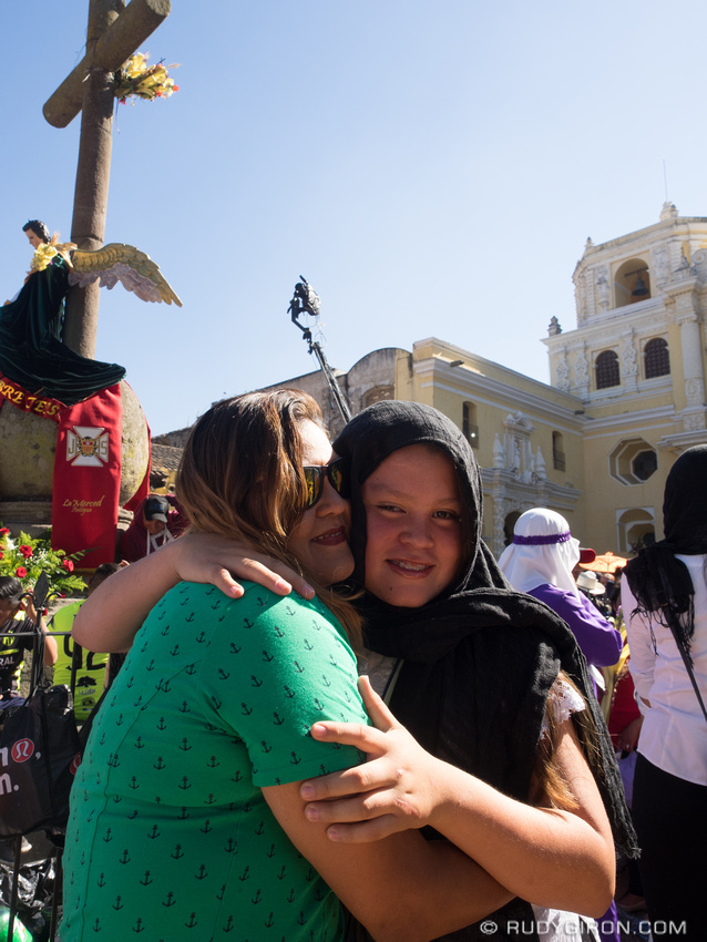 Rudy Giron: Antigua Guatemala &emdash; Mother and Daughter embracing during a Holy Week procession in Antigua Guatemala