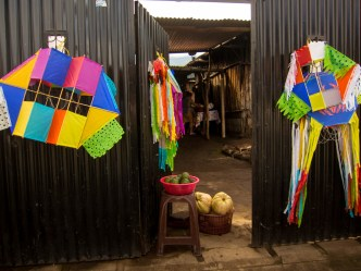 Kites on sale at a house in San Miguel Escobar, Ciudad Vieja by Rudy Giron