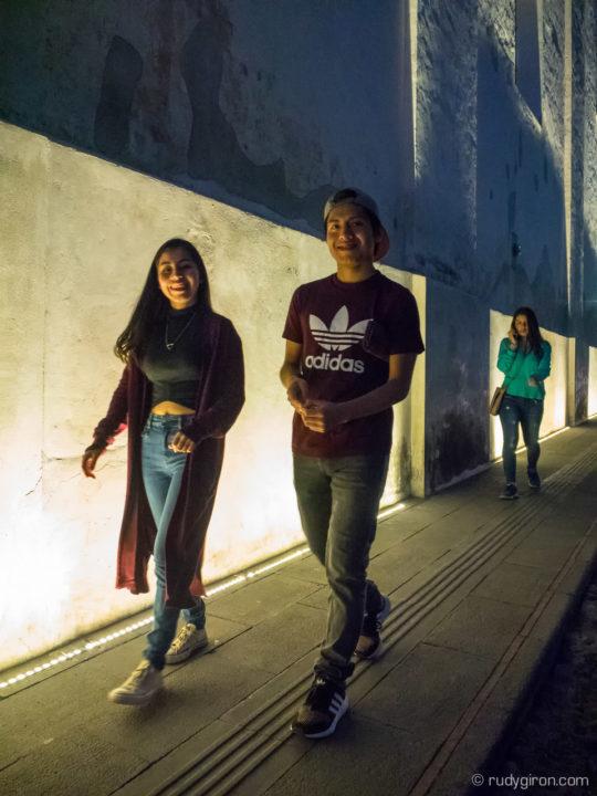 Teenager walking at twilight in Antigua Guatemala BY RUDY GIRON