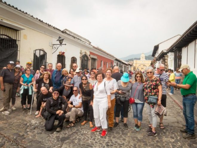 Cruise ship passengers enjoying the Antigua Photo Walks with RUDY GIRON at Calle del Arco, Antigua Guatemala