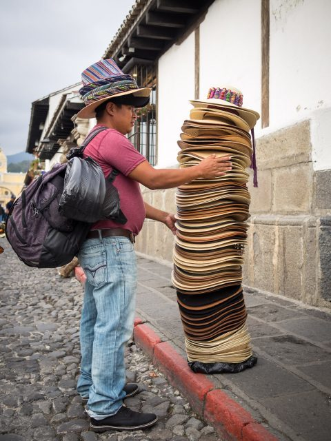 hat-ambulant-vendor-in-antigua-guatemala-480x640-7040551