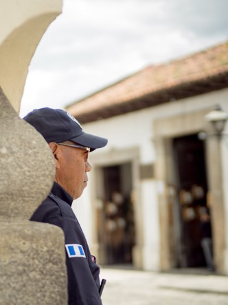 Typical Vistas of Antigua Guatemala: Municipal Police Officer at a Corner BY RUDY GIRON