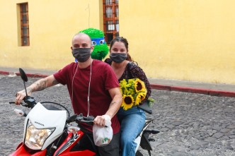 PHOTO STOCK: Couple with face masks doing errands on a motorcycle