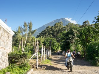 PHOTO STOCK: Motorcycle rider wearing a face mask in the back roads of Latin America
