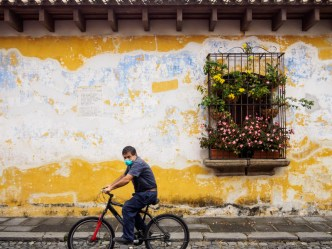 PHOTO STOCK: Man rides a bicycles as a mean of transportation during the pandemic in Antigua Guatemala