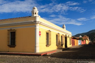 PHOTO STOCK: Colorful vista of yellow house and blue sky from Antigua Guatemala