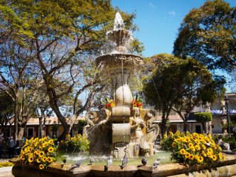 PHOTO STOCK: Fountain Decorated with Vibrant Flowers in Latin America