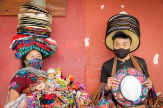 PHOTO STOCK: Portrait of Maya Mother and her Son Selling Handicrafts by RUDY GIRON