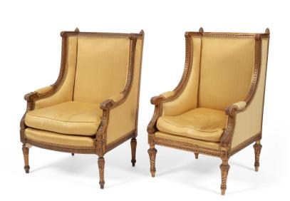 A pair of antique giltwood chairs in the Louis VXI style