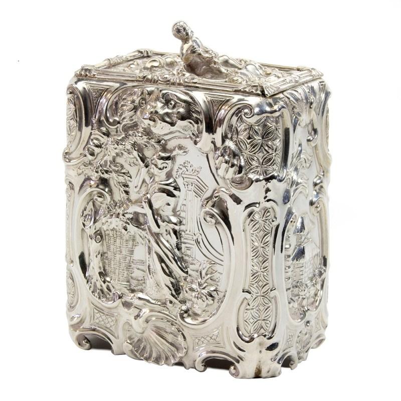 This silver tea caddy by Thomas Heming
