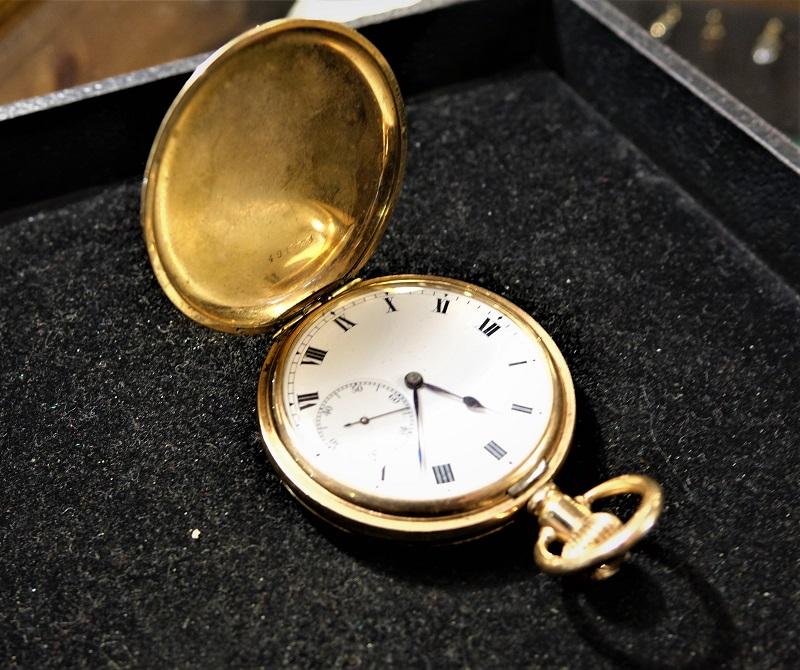 An antique gold plated pocket watch