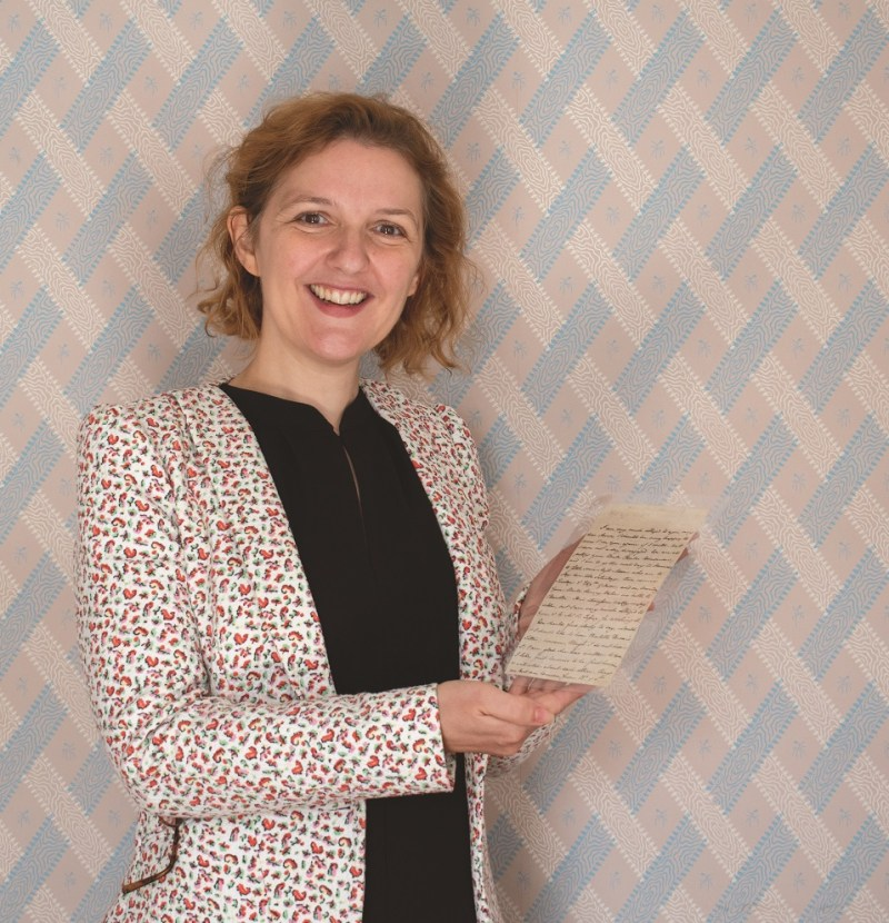 Dr Mary Guyatt, Director of Jane Austen's House Museum, with the newly acquired Jane Austen letter