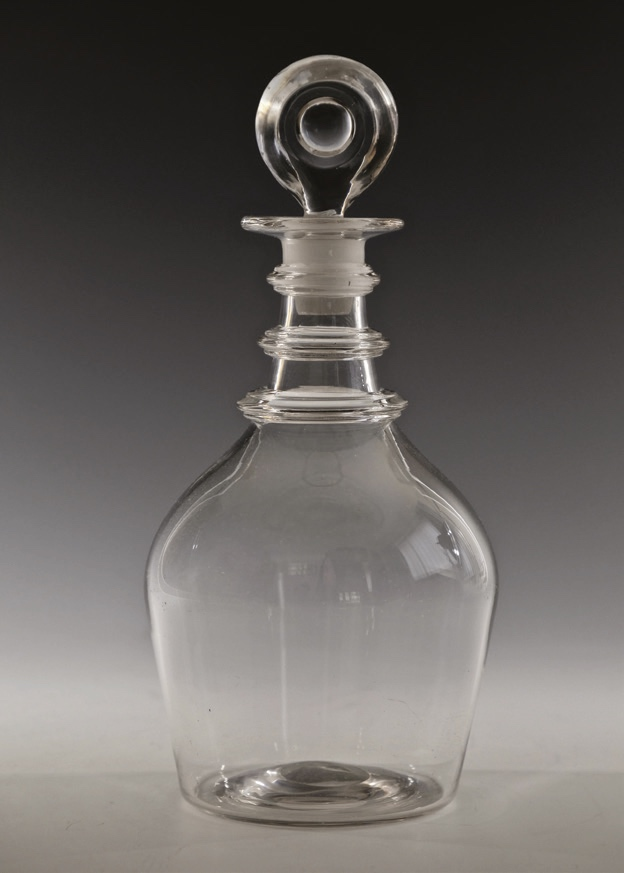 Bullseye stopper in an antique glass decanter