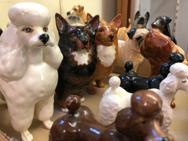 Various pottery dogs in Beswick Collection