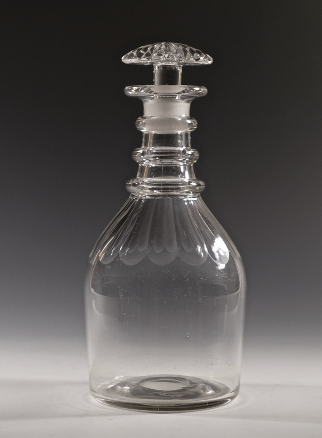 Mushroom stopper in an antique glass decanter