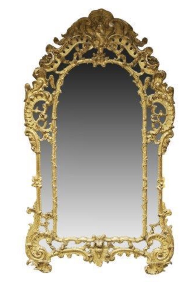 Régence style carved and gilded mirror