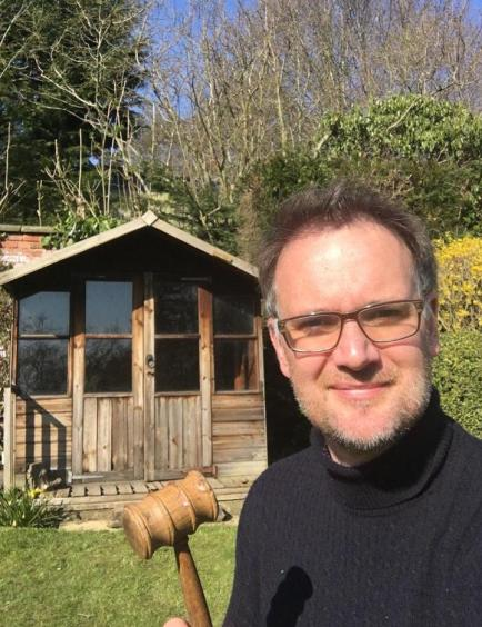Charles Hanson gets set for his charity auction in his garden shed