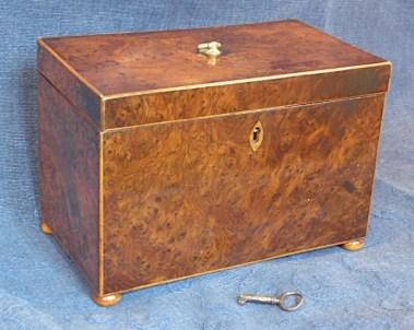An antique A burr yew tea caddy