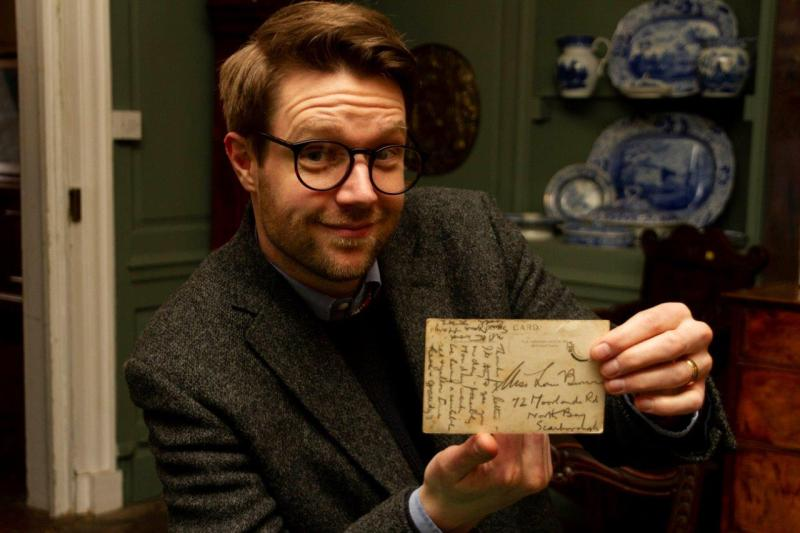 Hansons' valuer Jim Spencer with DH Lawrence postcard