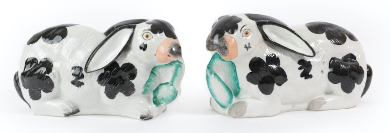 A pair of Staffordshire pottery rabbits