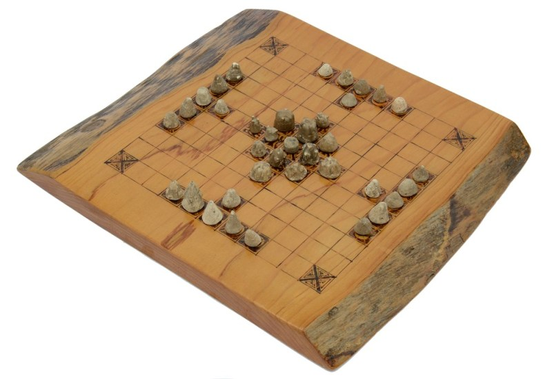 Viking gaming pieces on playing board