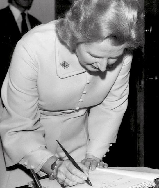 Margaret Thatcher signing a book