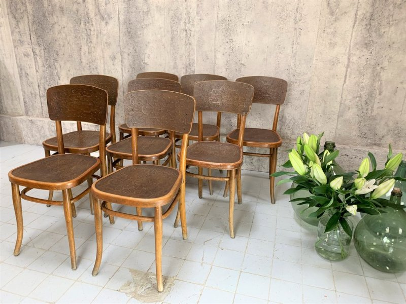 Set of eight Thonet embossed bistro chairs
