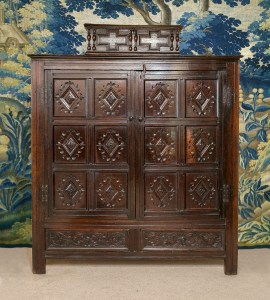 An antique livery cupboard