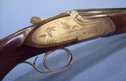 Etched ducked hunting scene on antique sporting gun