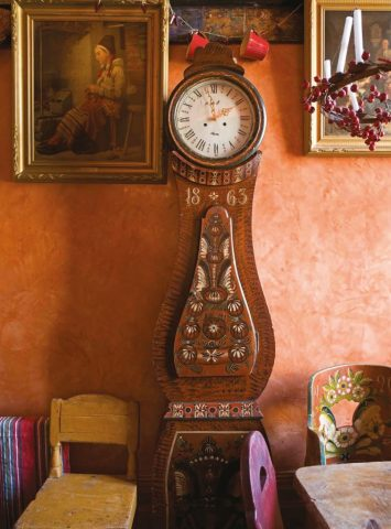 An antique Swedish Mora clock in a modern interior