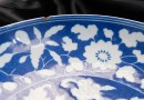 The chip in edge of antique Chinese dish at Hansons