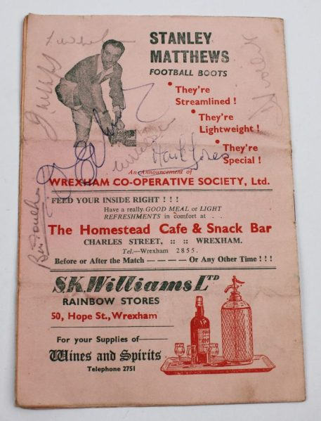 A football programme signed by seven Matt Busby's players