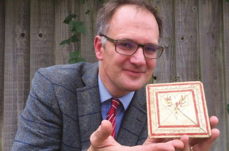 Auctioneer Charles Hanson with the antique love letter