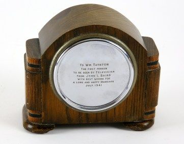 An inscribed clock given to the first man on television