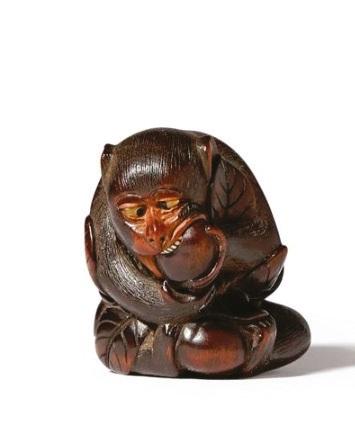 A Japanese art wooden netsuke of a monkey